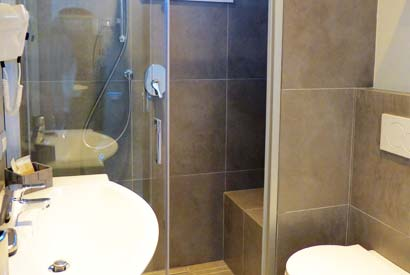 The bathroom in the deluxe rooms